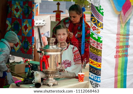 Surgut, Russia, 06/12/2018: Holiday Russia Day. Beautiful girls in national Russian costumes. #1112068463
