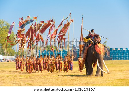 SURIN, THAILAND - NOVEMBER 20, 2010: A Burmese general marches in with his soldiers during the Burmese Siamese War reenactment at the Surin Elephant Roundup on November 20, 2010 in Surin, Thailand