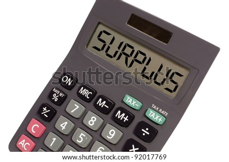 surplus written on display of an old calculator on white background in perspective