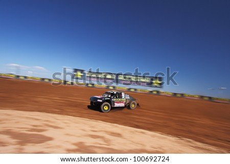 SURPRISE, AZ - SEP 23: Kyle LeDuc (99) at speed in Pro 4 Unlimited Lucas Oil Off Road Series practice on Sept. 23, 2011 at Speedworld Off Road Park in Surprise, AZ.