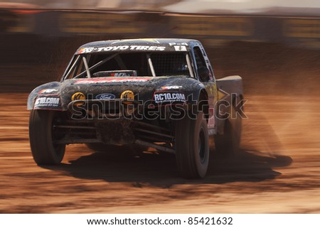 SURPRISE, AZ - SEPT 24: Todd LeDuc (4) at speed in Pro 4 Unlimited qualifying for Lucas Oil Off Road Series racing on Sept. 24, 2011 at Speedworld Off Road Park in Surprise, AZ.