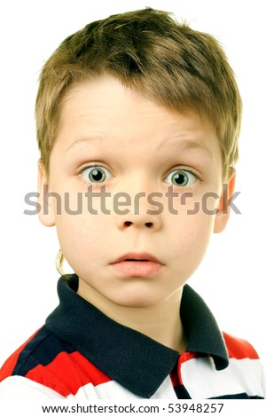 Surprise concept - boy with funny amazed expression on white background