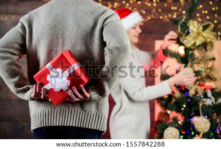 Surprise effect. Generosity and kindness. Prepare surprise. Giving and sharing. Winter surprise. Man carry gift box behind back defocused background. Christmas surprise concept. Surprising his wife.