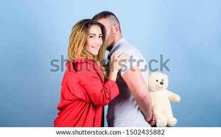 Surprise for sweetheart. Soft toy teddy bear gift. Surprise gift concept. Surprising her. Handsome man and pretty girl in love. Man and woman couple in love. Romantic surprise. Valentines day holiday. #1502435882