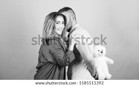 Surprise for sweetheart. Soft toy teddy bear gift. Surprise gift concept. Surprising her. Handsome man and pretty girl in love. Man and woman couple in love. Romantic surprise. Valentines day holiday.