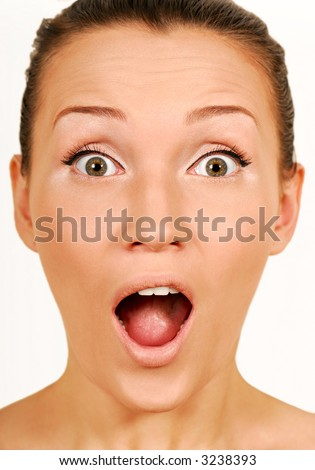 Surprise gesturing. Woman Face Wonderment. Close-up face.