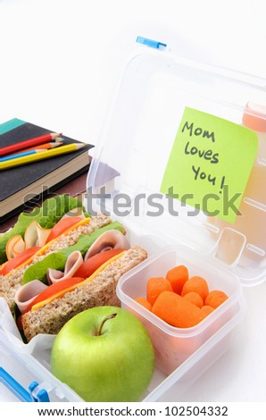 Surprise postie message in school lunch box filled with sandwiches and healthy food