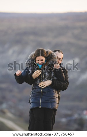 surprise proposal on hill in winter #373758457