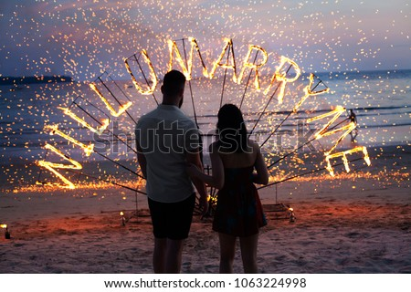 surprise propose merry me to wedding fire sunset  Stock photo ©