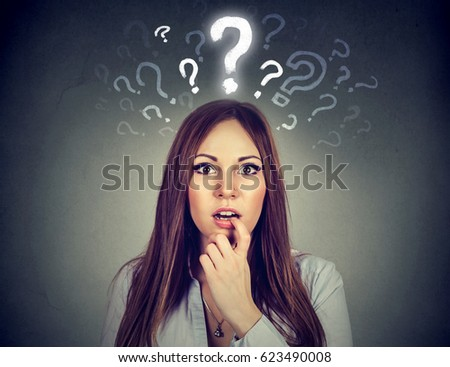 Surprised amazed young woman with many questions and no explanation or answer