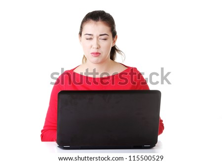 Surprised and disgusted woman working on laptop. Isolated on white.