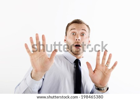 Surprised and scared businessman