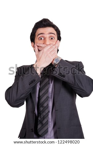 surprised and shocked businessman covering his mouth with his hands