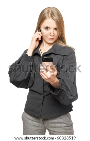 Surprised blonde in a gray business suit with two phones