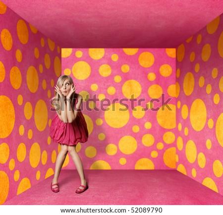 surprised blonde in pink dress in pink room