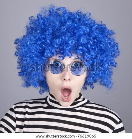 Surprised blue hair girl. Studio shot.