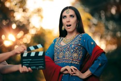 Surprised Bollywood Actress Wearing an Indian Outfit and Jewelry - Professional cinema star shooting a scene