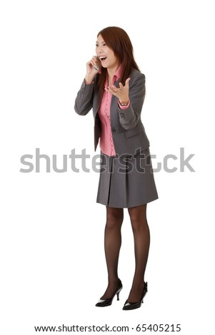 Surprised business woman in phone, full length portrait isolated over white.
