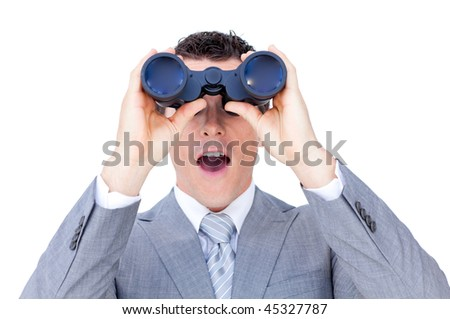Surprised businessman looking through binoculars against a white background