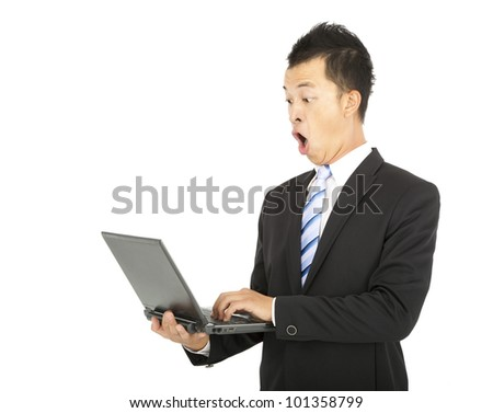 surprised businessman watching the laptop computer