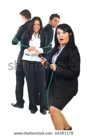 Surprised businesswoman trying to pulling  a group of businesspeople but they are stronger than woman,concept of a team is stronger than a single person - stock photo