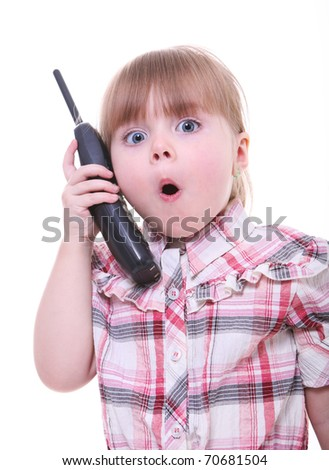 surprised child talking on the phone. little girl on the telephone