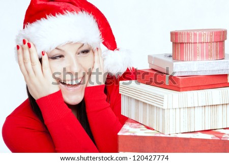 surprised christmas brunette woman with presents