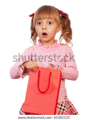 Surprised christmas girl holding shopping bag. Isolated on white background.