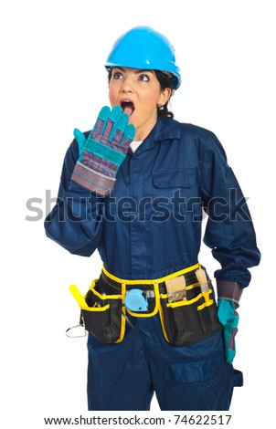 Surprised constructor worker woman looking away isolated on white background