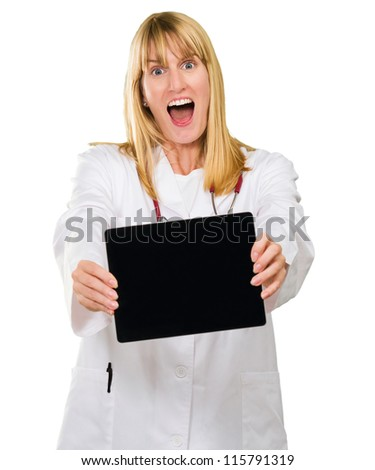 surprised doctor holding a digital tablet against a white background