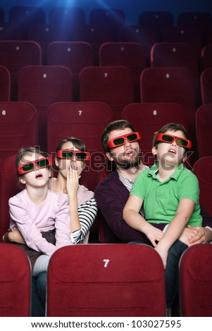 Surprised family watching a movie at the cinema