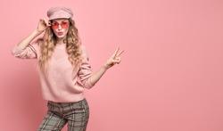 Surprised fashionable woman having fun in Trendy pink outfit. Studio shot of Carefree open-eyed stylish funny positive blonde girl. Cheerful fashion beautiful model, funny mood on pink