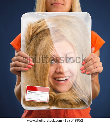 Surprised female head wrapped in food tray