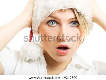 Surprised girl in Santa hat. - stock photo