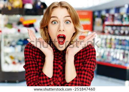 Surprised girl in the shop