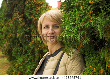 Surprised girl with big eyes near the green trees. Portrait. There is a model release. - Shutterstock ID 498295741
