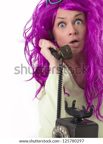 surprised girl with old phone