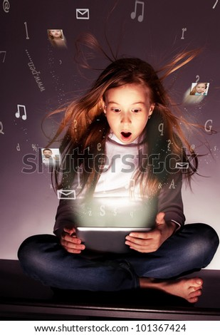 Surprised girl with tablet computer. Computer technology. Flow of information, letters, photos departing from the tablet