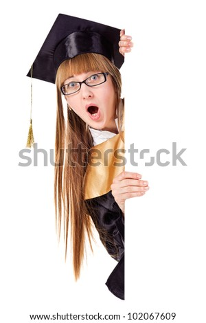 Surprised graduating woman holding a display for text. Isolated over white