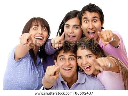 Surprised group of friends pointing to the camera - isolated over white
