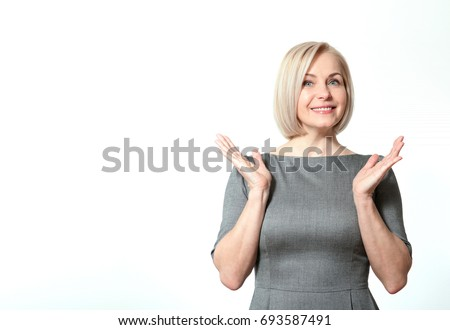 Shutterstock Surprised happy woman looking sideways in excitement. Isolated over white background. Portrait of happy aged woman.
