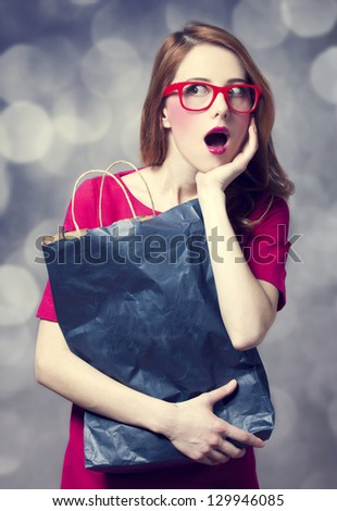 Surprised hipster girl with bag.