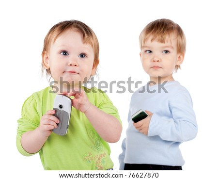 surprised little girl and boy the phone