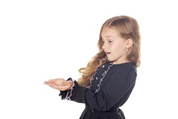 Surprised little girl holding something on the hands. Concept for adv. Isolated on white background.