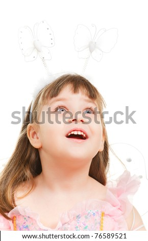 surprised little girl looking up, isolated on white