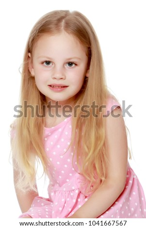 Surprised little girl. The concept of children's emotions. Isolated on white background. #1041667567