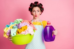 Surprised maid girl look hold dirty clothes basin wash powder bottle wear t-shirt isolated on pastel color background