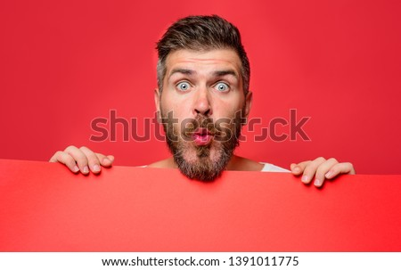 Surprised man holding advertising board. Advertising. Sale. Online shopping. Advertising banner. Seasons sale.