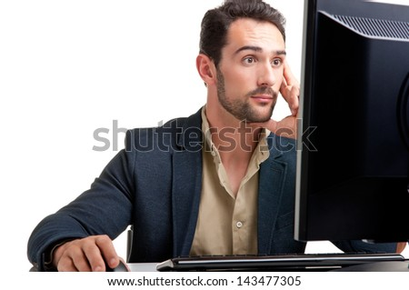 Surprised man looking at a computer screen, thinking about the job at hand