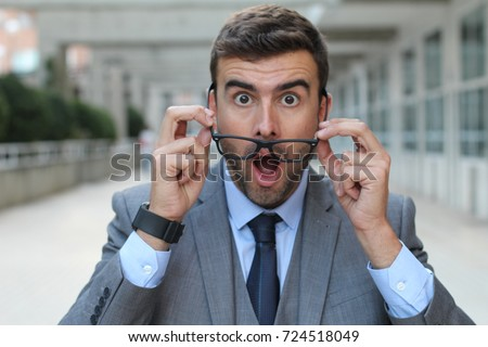 Surprised man with glasses close up #724518049